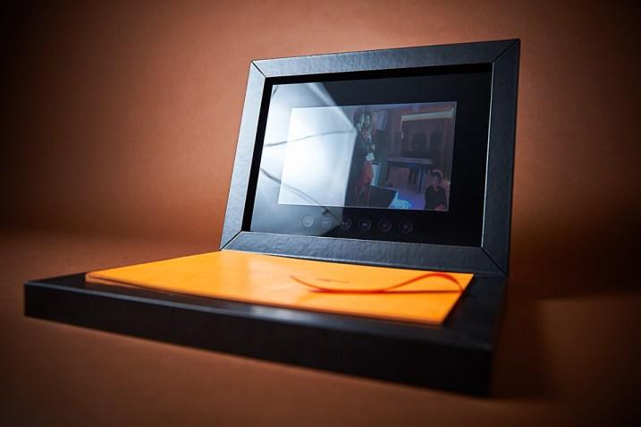 custom luxury wedding album with video display in orange and black theme