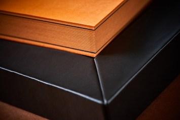 luxury wedding album in orange and black colour