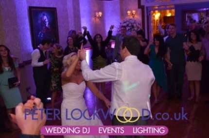 wedding-guests-circle-the-bride-and-groom-for-the-big-finale-in-nunsmere-hall
