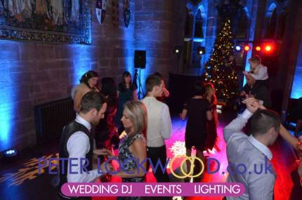 wedding-guests-haveing-a-good-time-in-peckforton-castle