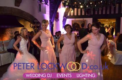 bride-and-bridemaids-having-fun-in-samlesbury-hall