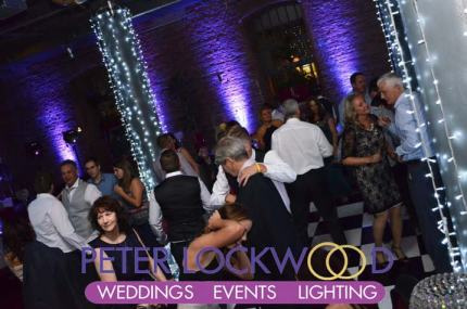 stunning-purple-wedding-lighting-with-white-pillar-lighting