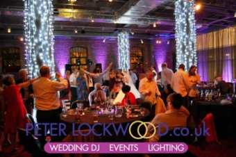 wedding-purple-mood-lighting-and-bright-white-pilar-lighting-by-peter-lockwood