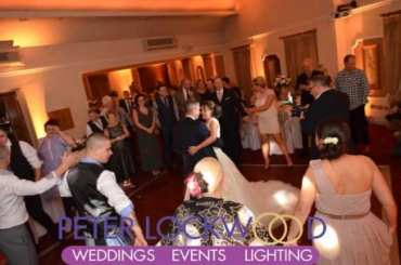 gold wedding lighting in the red hall