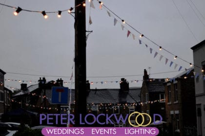 festoon lights over the street for saddleworth band contest