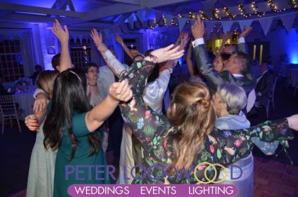 Hands in the air at a Quarry Bank Mill Wedding