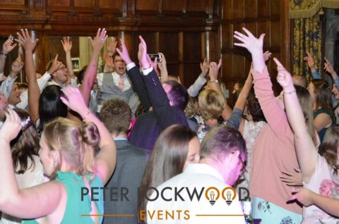 hands in the air at a wedding