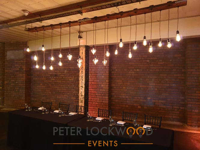 wedding top table Edison bulb installation