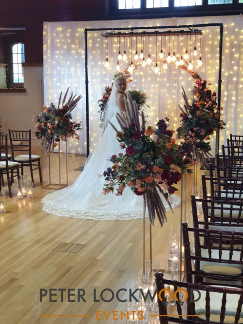 wedding aisle lighting and backdrop