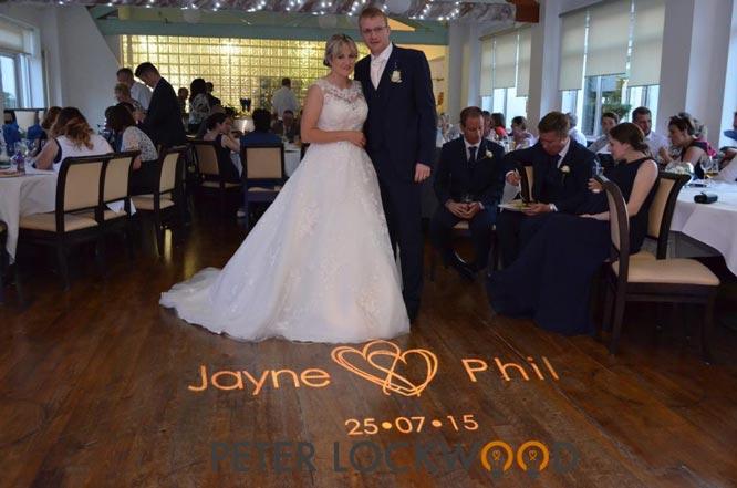 floor projection of a wedding monogram