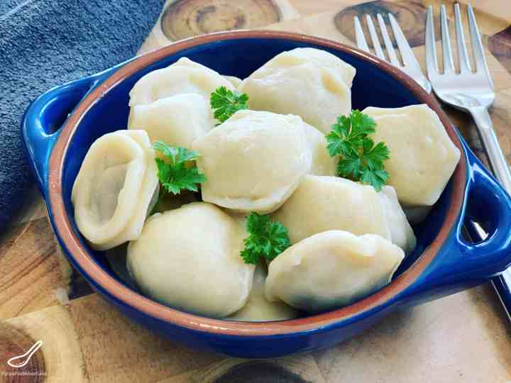 These Russian dumplings are so much quicker with this shortcut using a Pelmenitsa Mold! Filled with turkey meat and onion with an Asian twist - How to make Siberian Ravioli Pelmeni using a Mold