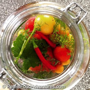 Bursting with flavor, this tomato and vegetable mix is delicious. Quick pickled with cilantro, basil and dill, I could drink the sauce! Reminds me of a tomato Giardiniera - Marinated Pickled Tomatoes (малосольных помидоры)