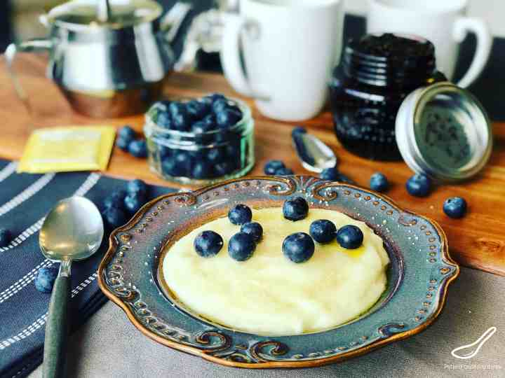 Cream of wheat on a breakfast table with fresh blueberries