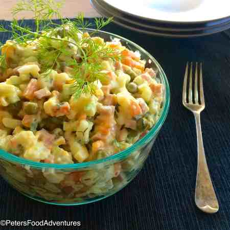Olivye Salad is a delicious Russian Potato Salad that's popular around the world. Also known as Olivier, Ensaladilla rusa, Rus salatası, ρώσικη σαλάτα, bramborový salát and more. Olivier Salad Recipe (салат Оливье)