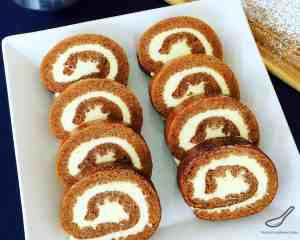Pumpkin Roll is the perfect holiday treat for Thanksgiving or Christmas! It's like a Pumpkin Swiss Roll or Roulade made with Pumpkin Pie Spice, generously slathered with vanilla bean cream cheese.