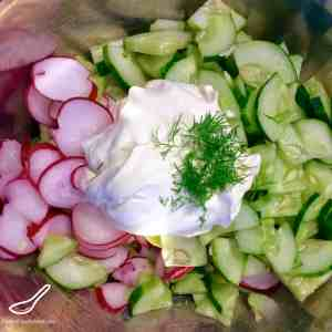 This simple and rustic salad is a delicious addition to your summer salad mix. Creamy, crunchy, healthy and full of flavour - Russian Radish and Cucumber Salad (Салат из редиски и огурца)