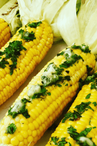 Close up of Grilled Corn with fresh herbs and butter
