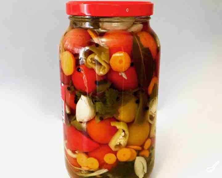 Enjoy your fresh, garden tomatoes by preserving them Russian-style. Pickled Tomatoes (солёные помидоры) with garlic and fresh herbs. I stuff extra vegables between the tomatoes to make pickled vegetables too. These canned tomatoes are a staple year round.