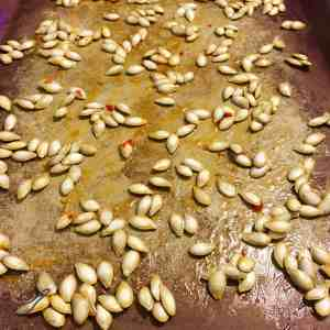 Sweet Chili Roasted Pumpkin Seeds on a tray