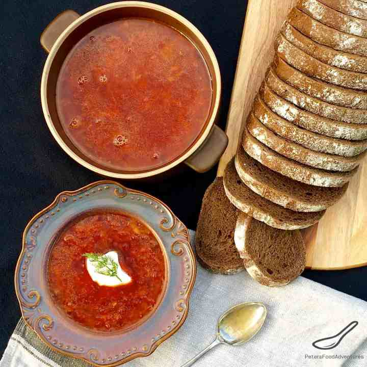 Red Beet Borscht served with rye bread and a dollop of sour cream