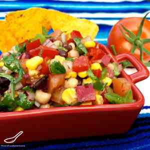 This Texan classic is sure to be King of the Bbq this summer! Toss the ingredients together and you're done! It's like a bean salad on steroids - This recipe is a keeper!