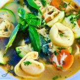 Easy Chicken Tortellini Soup with bacon and fresh basil. Delicious and hearty and loaded with vegetables. It's like a next level Minestrone Soup.