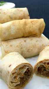 Russian Stuffed Blinchiki, also called Russian Crepes, Blintzes or Blini packed full of savoury meaty goodness.