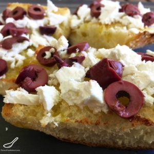 Toasted Turkish Bread with crumbled Feta, generously topped with Kalamata Olives. Fancy toast, perfect for breakfast, delicious lunch or easy snack - Toasted Turkish Pide Bread with Feta & Olives