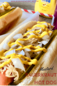 Delicious Sauerkraut Hot Dog with sliced dill pickles, onion and tasty mustard! A simple and tangy favorite! Hot Dog Topping Ideas Recipes