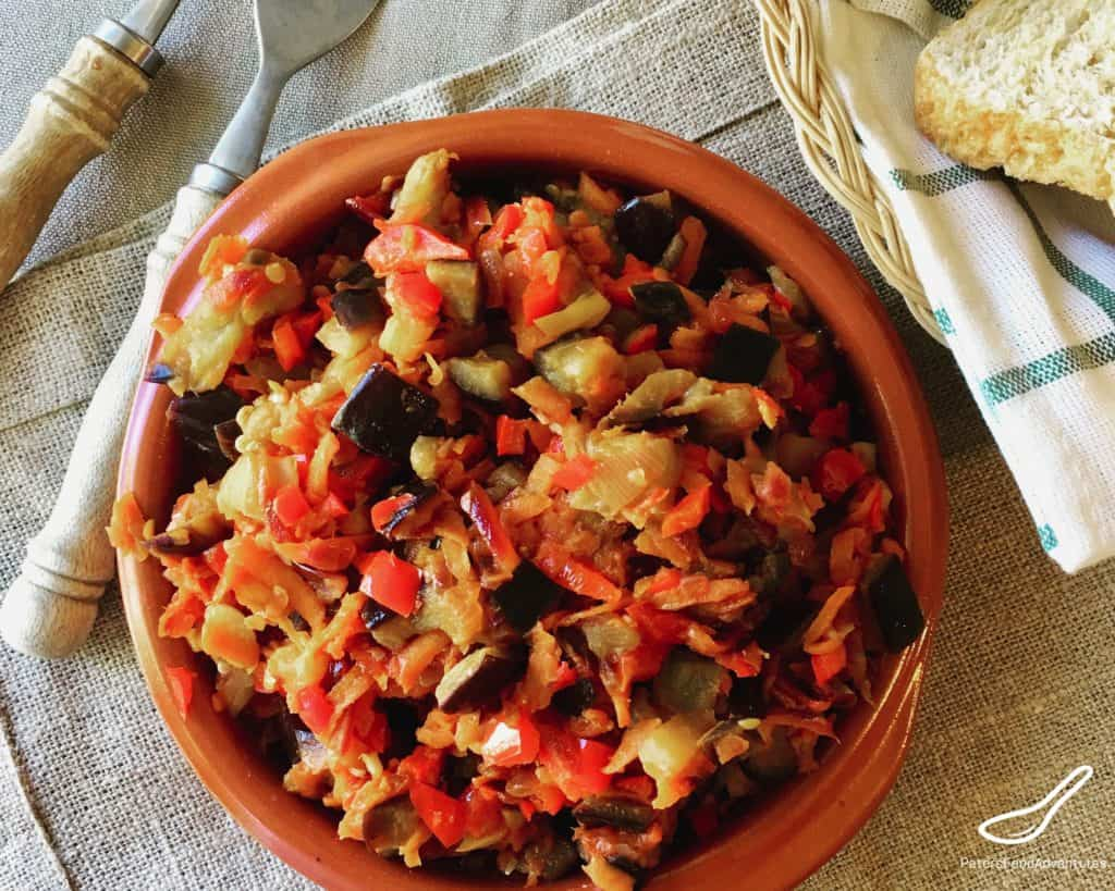 Russian Eggplant Caviar is a classic Russian spread made from eggplant (aubergines), carrot, peppers and tomatoes! Perfect on a piece of rye bread as an appetizer - (Баклажанная икра)