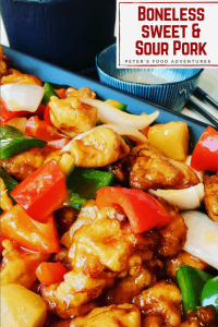 Boneless Sweet and Sour Pork recipe in a crispy batter, food court style. The sauce is so easy to make with the sweetness of pineapple, bell peppers and onion. Tastes just like take out!