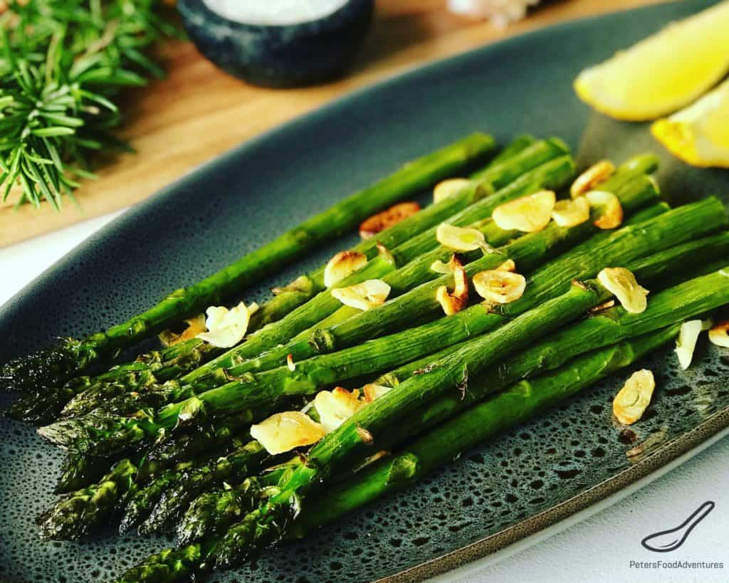 Roasted Asparagus with Garlic is such a healthy and easy side dish to make. Drizzle generously with Olive oil and toss with garlic pieces, the perfect side dish! Garlic Roasted Asparagus Recipe