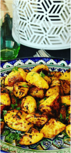 Moroccan Roasted Potatoes are so easy to make. A perfect side dish of crispy roasted potatoes, jam packed with spices like cumin, paprika, turmeric and optional spicy Harissa! No par-boiling, just crispy roasted on a baking sheet, perfect with your roast chicken dinner or a tagine meal!