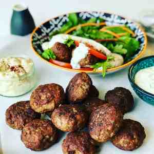 Lamb Patties in Pita Bread with salad is delicious summer meal or appetizer. It's like a small lamb burger, lamb meatball or lamb rissoles. Perfect as a lamb pita pocket or a lamb slider for lunch.