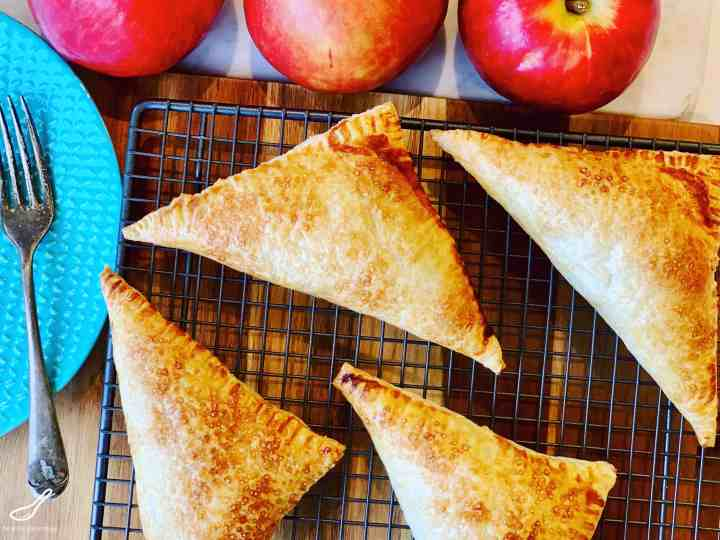 Apple Turnovers with Puff Pastry cooling on a baking rack