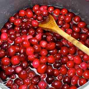 Cranberries cooking in a saucepan