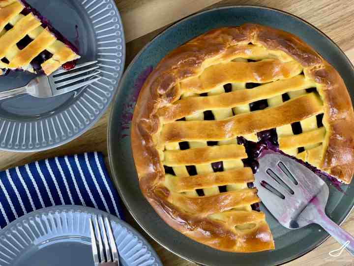 Looking top down on a lattice blueberry pie