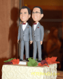 A close-up of the custom-made groom figures atop the cake