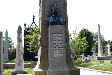 A closer view of the bust on Tyler's monument. President Monroe's tomb is visible in the background. - <i>Photo by John Dolan</i>
