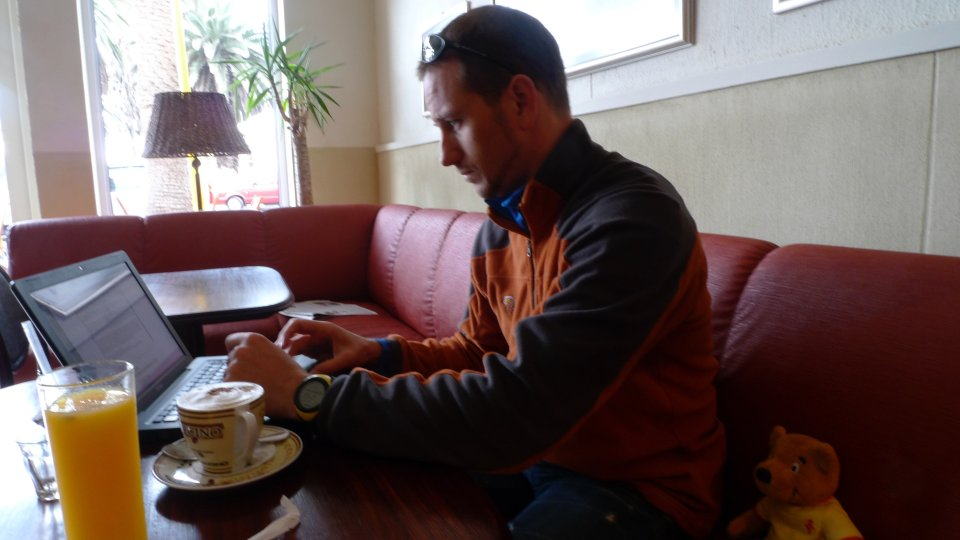 Peter Liptak with coffee and laptop in Swakopmund, Namibia 2009