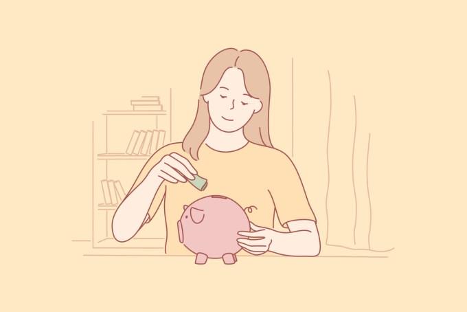 jeune fille qui met de l'argent dans sa tirelire