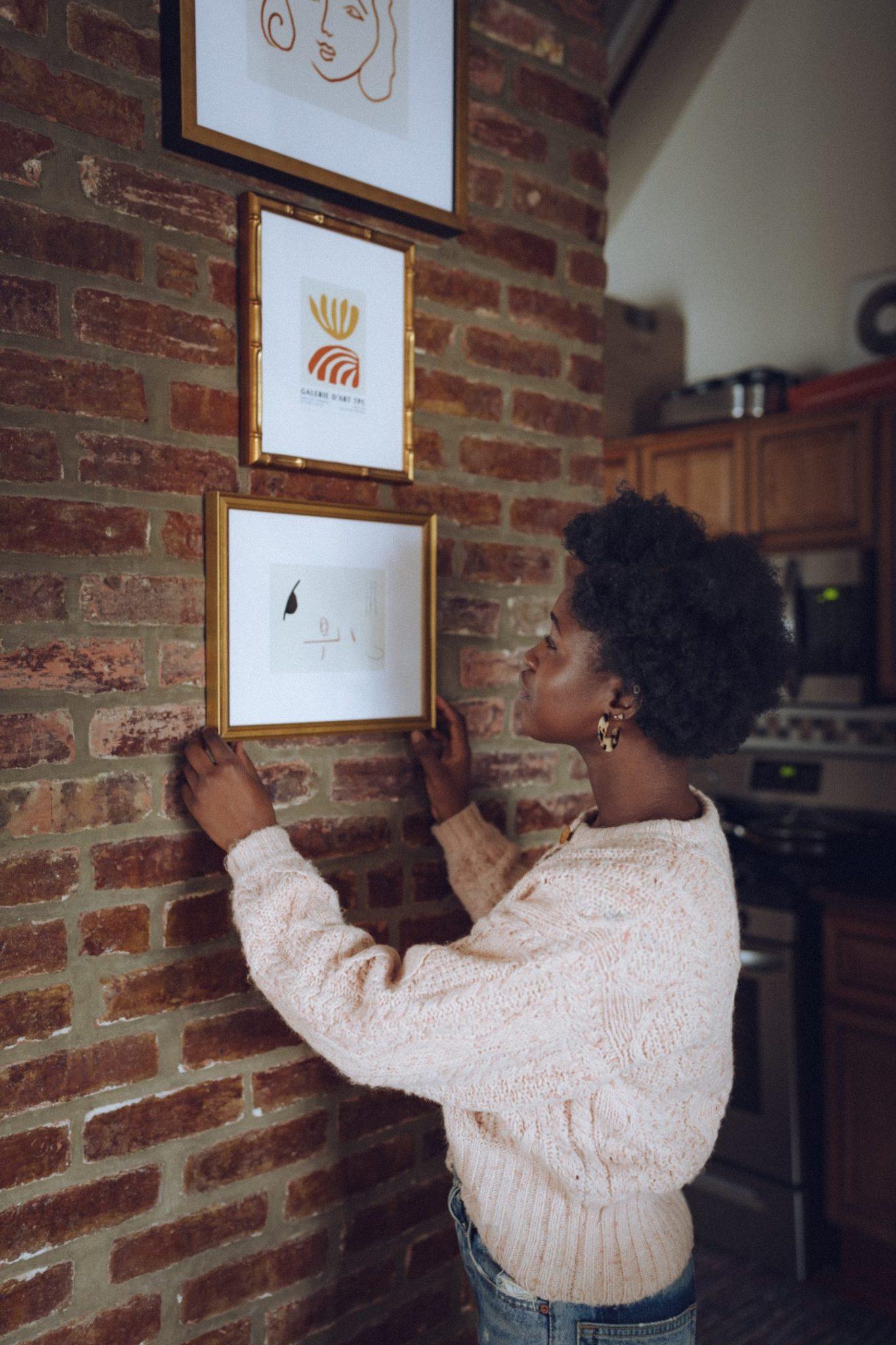 Women Hanging a Frame