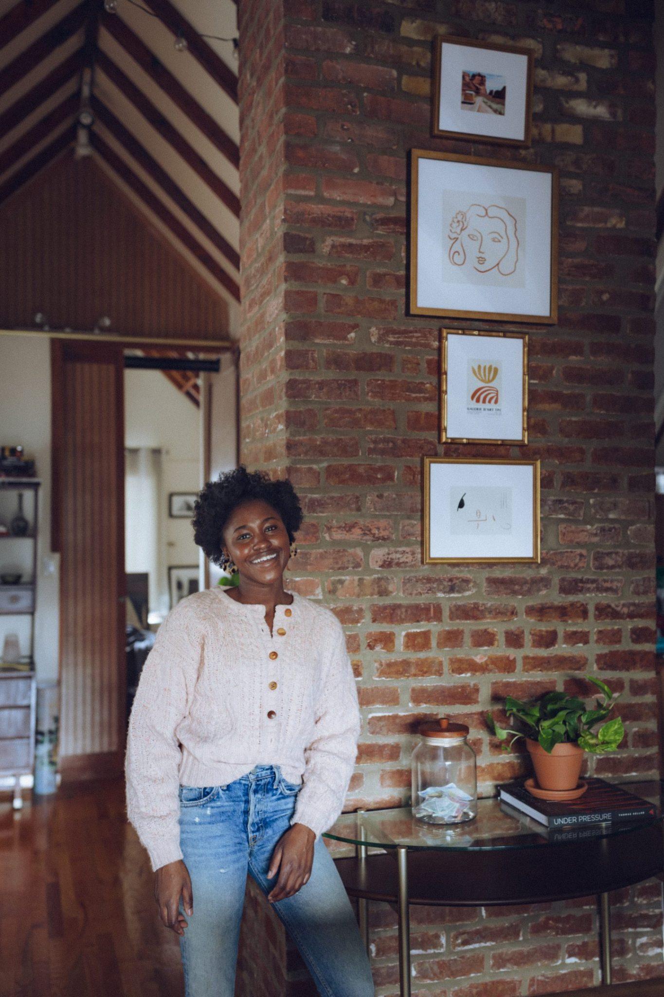 Women smiles near Gallery Wall