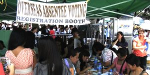 Filipinos-voting-in-Hongkong.-STANFORD.EDUabsentee_voting_registration_booth_july-20121