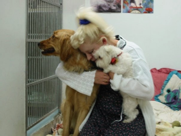 Theresa Garcia is a fierce advocate for lost pets that deserve veterinary care. Here, comforting two canines.