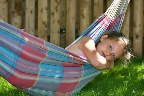 Little girl sleeping in hammock