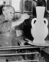 Spanish artist Pablo Picasso painting potery at the Madoura studio in Vallauris. (photo taken on October 22, 1961 by ANDRE VILLERS/AFP/Getty Images)