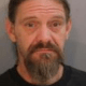 Man accused of running over dog
