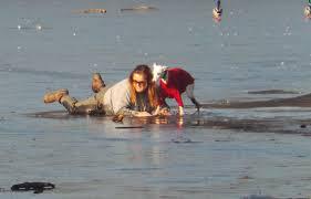woman crawls on ice 3