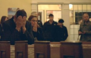 Community members gather at a memorial service after the Sandy Hook school shooting. Still from the documentary Newtown.